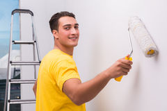 The man painting house in diy concept. Man painting house in DIY concept Stock Image