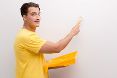 The man painting house in diy concept. Man painting house in DIY concept Royalty Free Stock Photography