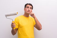 The man painting house in diy concept. Man painting house in DIY concept Royalty Free Stock Photo