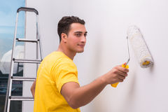 The man painting house in diy concept. Man painting house in DIY concept Royalty Free Stock Photos