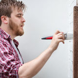 Man painting house wall with brush. DIY Home Improvement. Stock Photo