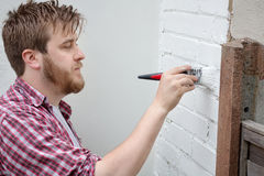 Man painting house wall with brush. DIY Home Improvement. Stock Images