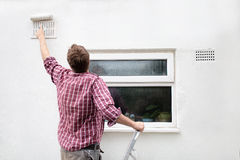 Man painting house wall. DIY Home Improvement. Stock Photography