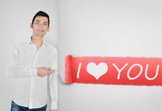 Man painting I love you word on wall Royalty Free Stock Photos