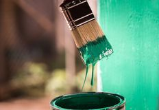 Painting metal surface with a brush Royalty Free Stock Image