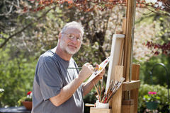Man Painting Outdoors Royalty Free Stock Photography