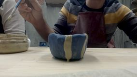 Man painting pottery stock video footage