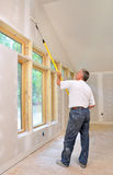 Man painting room with roller. Attached to extension pole royalty free stock photos