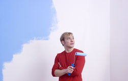 Man painting room with roller Stock Photos
