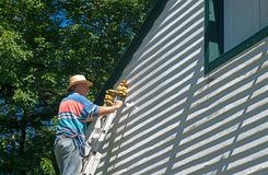Man Painting Siding Garage Royalty Free Stock Photo