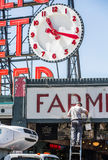 Man Painting Sign at Pike Street Market Royalty Free Stock Photography