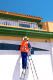 Man Painting on Stepladder Stock Image