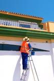 Man Painting on Stepladder Stock Image