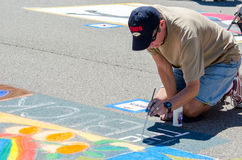 Man painting the street Royalty Free Stock Photo