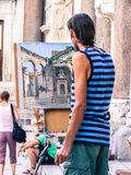 Man painting on the street. In Split, Croatia royalty free stock photography