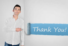 Man painting Thank you word on wall stock images