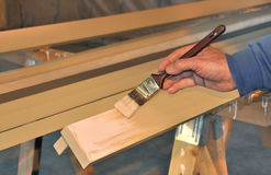Man painting trim boards royalty free stock image
