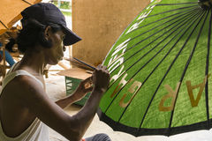 Man painting umbrella Stock Photo
