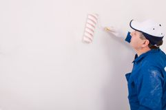 Man painting a wall Royalty Free Stock Photos
