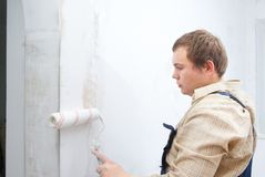Man painting wall Stock Photos