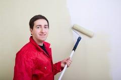 Man painting a wall royalty free stock image