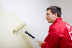 Man painting a wall Royalty Free Stock Photography