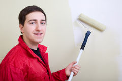 Man painting a wall Stock Photo