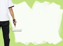 Man painting a wall Stock Image