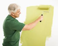 Man painting wall. Stock Photos