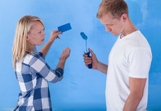 Man painting wall for bad colour Royalty Free Stock Images