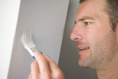 Man painting wall, close-up Stock Photo