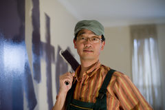 Man painting the wall. On house Stock Image