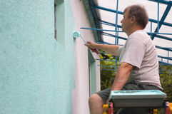 Man painting wall with a roll Royalty Free Stock Image