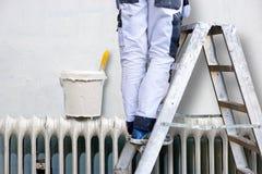 Man painting wall Stock Image