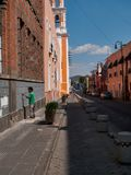Man painting the wall in street of Mexican city stock photos
