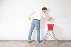 Man painting a wall Stock Images