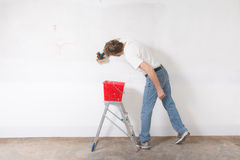 Man painting a wall Royalty Free Stock Images