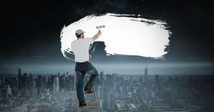 Man painting white over surreal dark city. Digital composite of Man painting white over surreal dark city royalty free illustration