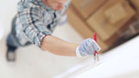 Man painting with white paint stock footage