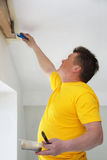 Man Painting a Exposed Beams Stock Photos