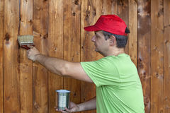 Man painting wooden wall Stock Photography