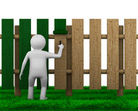 Man paints fence on white background Royalty Free Stock Photography