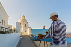Man paints  sea and Church Royalty Free Stock Photography