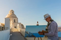 Man paints  sea and Church Stock Photo