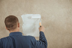 Man paints the wall Stock Photo