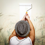 Man paints the wall. Royalty Free Stock Photos