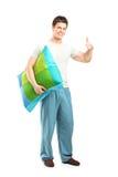 Man in pajamas giving thumb up Royalty Free Stock Photo
