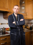 Man in pajamas in his kitchen Stock Photos
