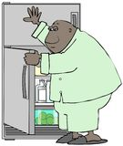 Man in pajamas raiding the refrigerator Stock Photo