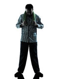 Man  pajamas sleepy  tired silhouettes Royalty Free Stock Photo